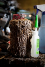 A glue bottle sculpted by years of use.