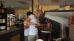 Baristas prepare specialty coffees & teas for patrons.